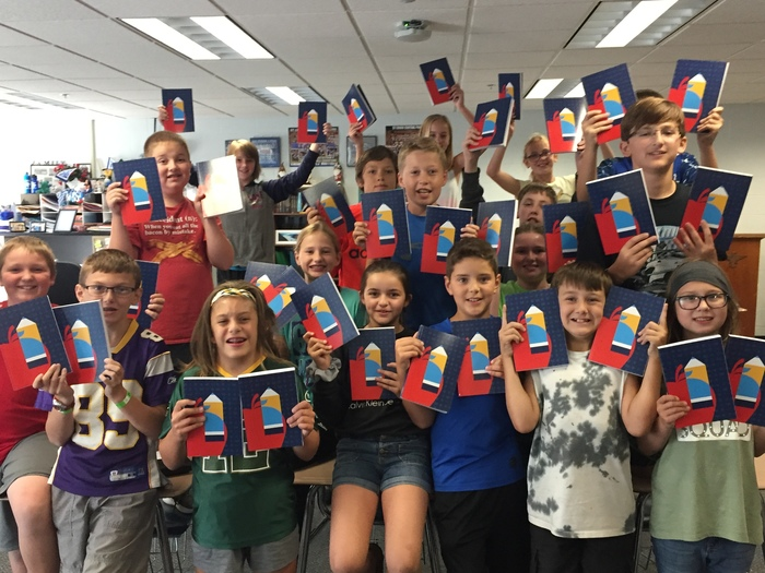 Miss Johnson's 6th graders showing their appreciation for the donation of notebooks from Flagship Ford.