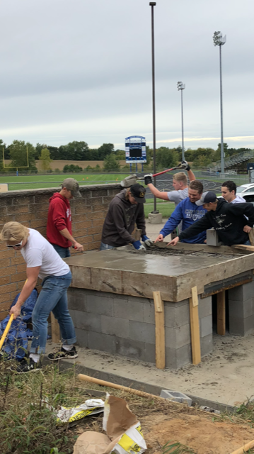 Panther Pizza is one step closer to becoming a reality with the help of Mr. Wenzel's class pouring the concrete for the brick oven pizza.
