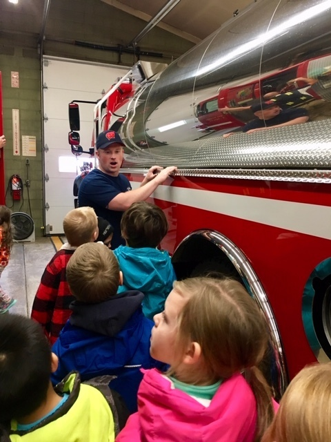 Students from Mrs. Cicha's class exploring the fire trucks.