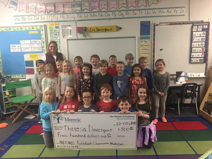 Mrs. Davenport's first graders accepting the check