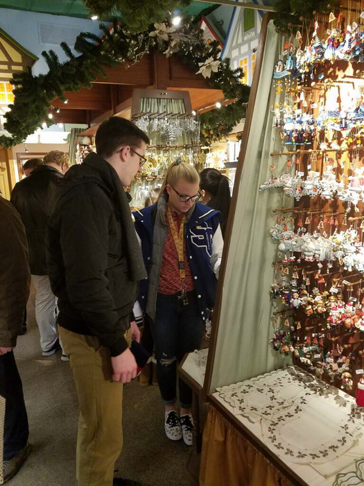 Students at a German Christmas store looking at ornaments