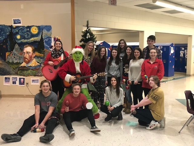 Ms. Wollberg's Spanish Class is in the Holiday Spirit traveling to different classrooms singing Feliz Navidad.
