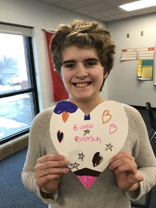 Student with heart wishing a happy new year