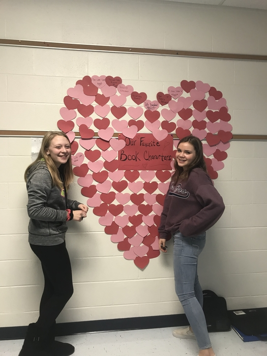 Eighth graders Maddy and Keira set up the LA8 Valentine display. Who is your favorite book character?