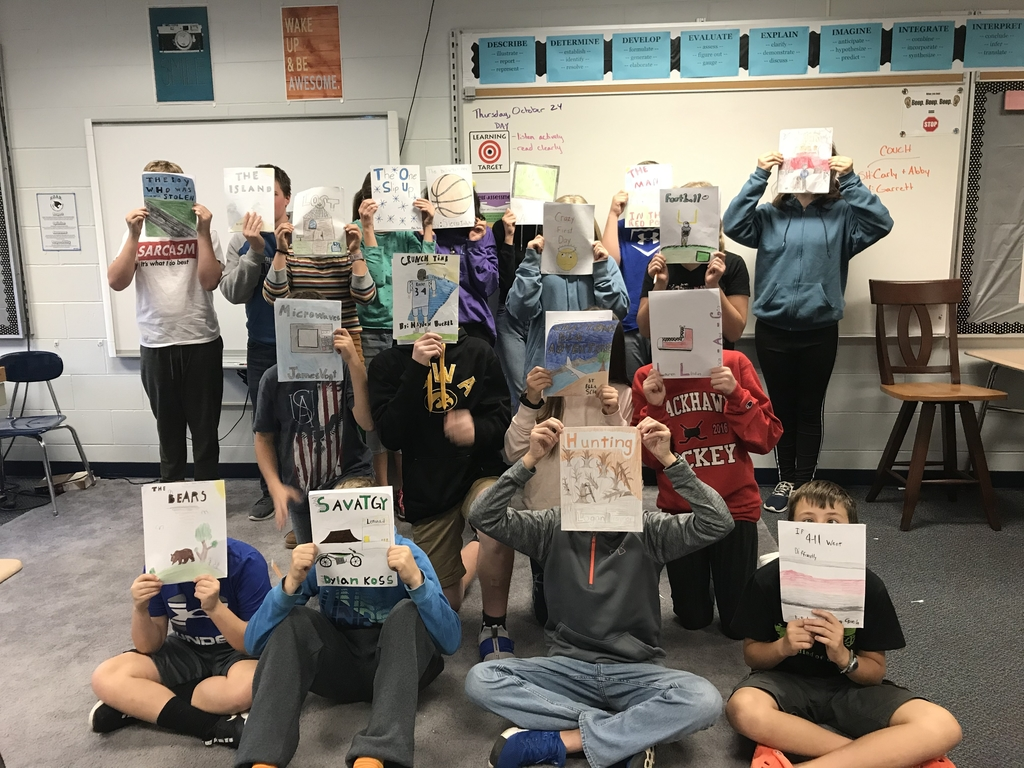 Students holding book covers