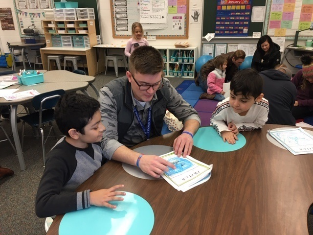 Mr. Linsmeyer reads with Mrs. Cicha's class